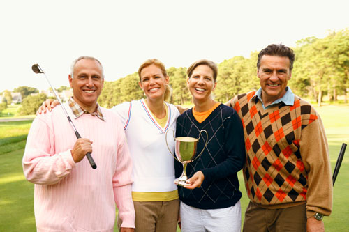 Golfers standing together smiling